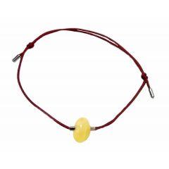 Bransoletka z bursztynem na bordowym sznurku